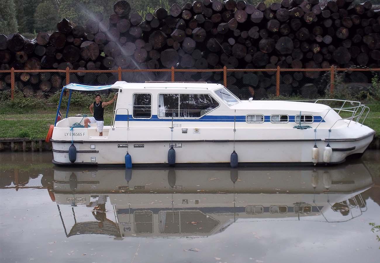 location bateau Triton 1050